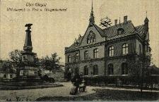 Głogówek : plac Wilhelma z budynkiem poczty, pomnik